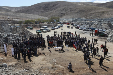 Chilean rescued miners, locals and authorities gather during an official ceremony to commemorate rescue anniversary at San Jose Copper copper and gold mine near Copiapo city