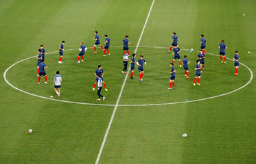South Korea's players stretch during a soccer training session in the Pantanal arena in Cuiaba ahead of their 2014 World Cup Group H soccer match against Russia