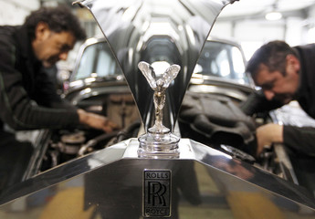 The mascot is seen on a Rolls Royce Silver Cloud II countryman motor car as mechanics work at the Continental Automobile dealership in Villeneuve sur Lot