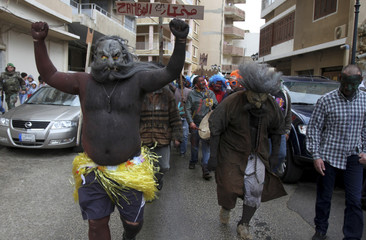 Christian residents of the coastal city of Tripoli, northern Lebanon, perform during a parade at the annual carnival of Zambo, preceding Clean Monday