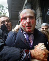 Former conservative Minister of Transportation Kostis Hatzidakis is covered with blood after about 200 leftists attacked him with stones and sticks in central Athens