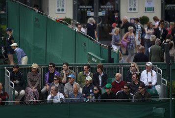 Spectators watch the match between Vania King of the U.S. and Petra Martic of Croatia at the Wimbledon tennis championships in London