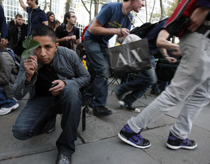 A man hides behind a leaf as he partakes in the mp3 experiment in New York's Bryant Park
