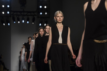 Models present creations from the Victoria Beckham Fall 2014 collection during New York Fashion Week