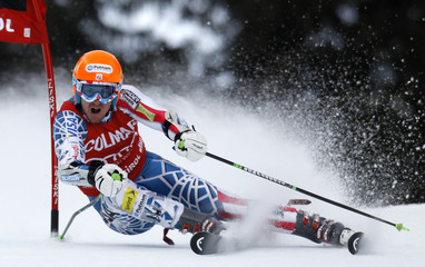 Ted Ligety of the U.S. clears a gate during the first run in the men's giant slalom Alpine Skiing World Cup event in Alta Badia