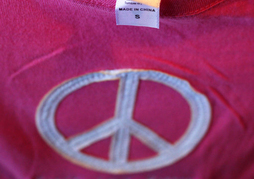 """The label reading """"Made in China"""" on a t-shirt is seen at a souvenir stand in Boston"""