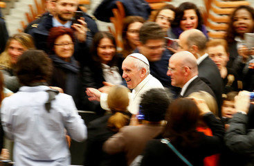 Pope Francis leaves at the end of a special audience with Vatican workers in Paul VI hall at the Vatican