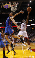 Miami Heat' James shoots as Oklahoma City Thunder's Collison defends in the first half during Game 4 of the NBA basketball finals in Miami
