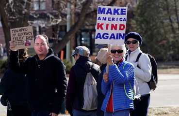 People march to voice their disapproval of U.S. President Donald Trump's policies downtown Boulder