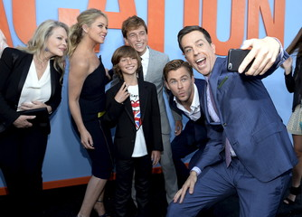 """Cast member Ed Helms takes a selfie of fellow cast members during the premiere of the film """"Vacation"""" at the Regency Village Theatre in the Westwood section of Los Angeles"""