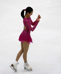 Mao Asada of team Japan reacts after performing during the ladies' singles short program during China ISU Grand Prix of Figure Skating , in Beijing