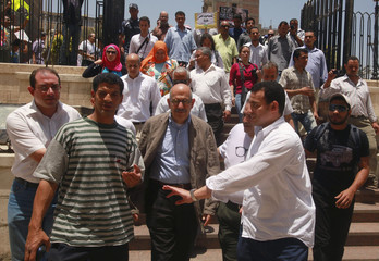 Former head of the U.N. nuclear agency Mohamed ElBaradei is surrounded by his supporters during his visit to Amr Ibn El-Aas mosque in Old Cairo