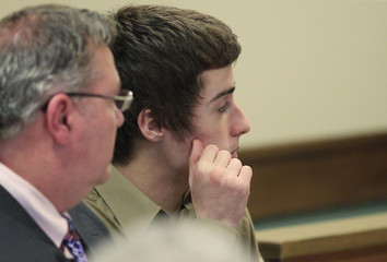 Lane sits with his attorney Lavelle at juvenile court hearing to determine whether he will be tried as an adult for the shooting death of three students in Chardon, Ohio