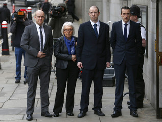 Elizabeth Blakelock, widow of Police Constable Keith Blakelock, and her sons Lee, Kevin and Mark arrive at the Old Bailey courthouse in London