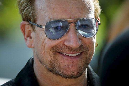 Irish singer Bono attends the unveiling of a tapestry honoring John Lennon at Ellis Island in New York