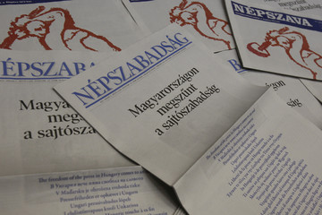 Two left-leaning Hungarian dailies carry protests on their front pages against a new media law in Budapest