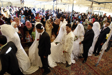 Jordanian brides and grooms take part in a mass wedding ceremony in Amman