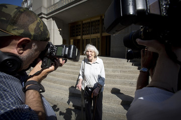 Miriam Moskowitz walks out after a status conference in her case outside the Manhattan Federal Court building in New York