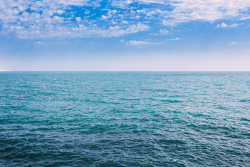 Sea Ocean And Blue Sky Background With Cloudscape in Summer