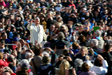 Pope Francis waves as he arrives to lead his general audience in Saint Peter's Square at the Vatican