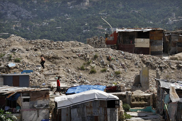 People walk in the destroyed neighborhood of Fort-Liberte in Port-au-Prince