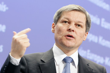 European Commissioner in charge of Agriculture Ciolos gestures during a news conference at the EC's Headquarters in Brussels