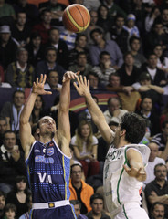 Argentina's Ginobili throws the ball as Brazil's Guilherme tries to block the shot during final round of FIBA Americas Championship basketball game in Mar del Plata