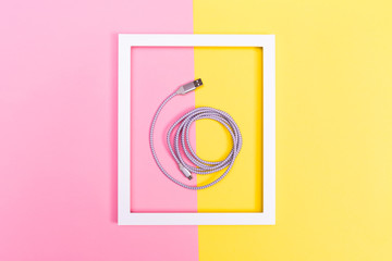 USB cable and frame on split background