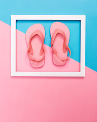 Beach sandals and frame on a bright background