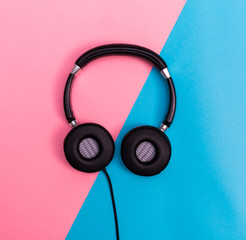 Headphones on a bright split background