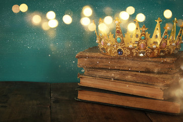 queen/king crown on old book. vintage filtered. fantasy medieval period