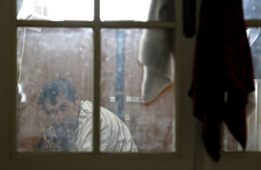 An Afghan asylum who is on a hunger strike rests in a room at a private house made available for them in Brussels