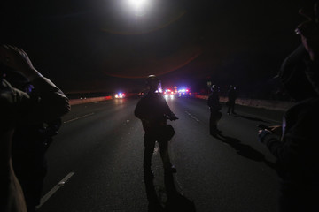Members of the California Highway Patrol stand guard on Highway 80 during a march against the New York City grand jury decision to not indict a police officer in the death of Eric Garner in Berkeley