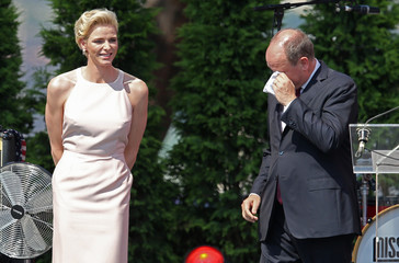 Prince Albert II of Monaco reacts to a speech by Princess Charlene of Monaco during celebrations to mark Prince Albert II's decade on the throne