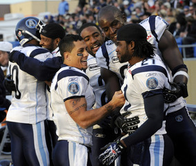 Argonauts' Owens celebrates with Shell and other teammates after defeating Blue Bombers during Canadian Football League action in Winnipeg