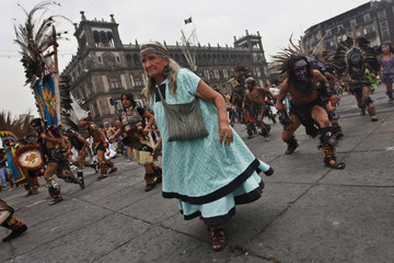 Dancers perform pre-Hispanic dances during the celebration of 687th anniversary of the foundation of Mexico-Tenochtitlan at Zocalo square in Mexico City
