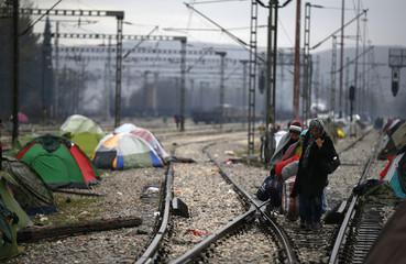 Migrants arrive at a makeshift camp at the Greek-Macedonian border near the village of Idomeni