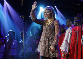Alison Krauss waves to the crowd after performing at the Berklee College of Music Commencement Concert in Boston