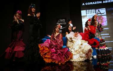 Models present creations by Inma Castrejon during the International Flamenco Fashion Show SIMOF in the Andalusian capital of Seville