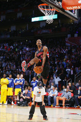 East All-Star Terrence Ross of the Toronto Raptors competes in the slam dunk contest during the NBA basketball All-Star weekend in Houston