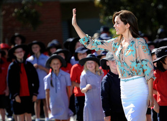 Denmark's Crown Princess Mary waves to the crowd after her arrival to Pakenham Springs Primary School in Melbourne
