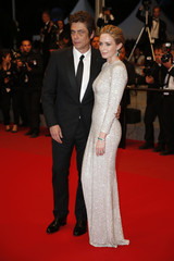 """Cast members Emily Blunt and Benicio Del Toro pose on the red carpet as they leave after the screening of the film """"Sicario"""" in competition at the 68th Cannes Film Festival in Cannes"""