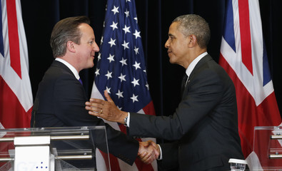 U.S. President Barack Obama and British Prime Minister David Cameron shake hands after holding a news conference at the G7 Summit in Brussels