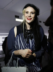Musician Nash leaves the Bora Aksu Spring/Summer 2014 collection presentation during London Fashion Week