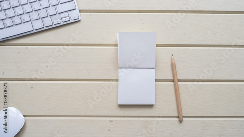 Wall mural workspace desk with keyboard  and notebook background wood