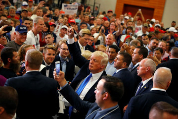 U.S. Republican presidential candidate Donald Trump greets supporters at a campaign rally at the Sharonville Convention Center in Cincinnati, Ohio