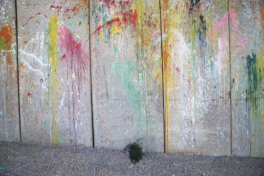 Paint is splashed against a section of the separation barrier in the West Bank city of  Abu Dis