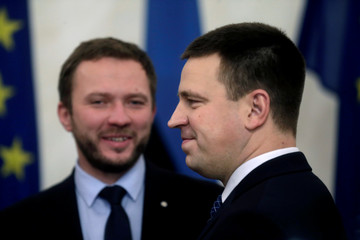 Estonia's new Prime Minister Ratas and Minister of Defence Tsahkna smile after the oath taking ceremony at the Parliament in Tallinn