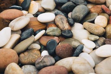 Background of riverstones pile, beautiful round stones.