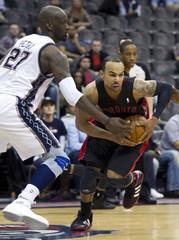 New Jersey Nets Johan Petro tries to block Toronto Raptors Jerryd Bayless in NBA basketball game in Newark